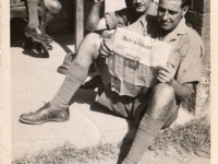 Keeping up-to-date with the news. Friends from 243 Squadron RAF, Ambala, India, 1944.
