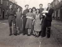 Keady Row, Gilford, Co Down (1945). Belgian soldiers from 4th Infantry Brigade (Steenstraede) photographed with (from l. to r. Bella McConville, Bernadette Fitzpatrick, Sally McConville, Mary McManus and Collins McManus holding baby Wendy McManus.