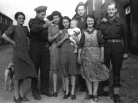 Keady Row, Gilford, Co Down. (1945). Belgian soldiers from 4th Infantry Brigade (Steenstraede) photographed with (from l. to r.) Bella McConville, Sally McConville, Bernadette Fitzpatrick holding baby Wendy McManus and Mary McManus.