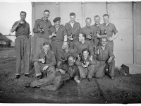 Workparty from 297 Coy Royal Engineers relax with a beer. Frank Melville, (Dundee) extreme right back row. (1944)