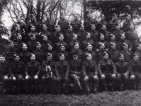 Platoon of men from 583 Coy Royal Engineers photographed whilst encamped at Gilford Castle, Co Down. Sergeant T Webb (man with dog) - brother-in-law of Freddie French. (1943)