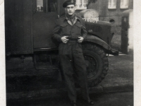 Royal Engineer Freddie French alongside his vehicle in Germany. (1944)