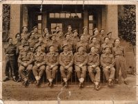 Royal Engineers Headquarters Group photographed with their Padre, at Luke near the River Elbe in Germany. Freddie French, 4th left, 2nd row from front. (1945)