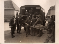 Men from 11th Light Field Ambulance Unit RAMC photographed at Belsen Concentration Camp.