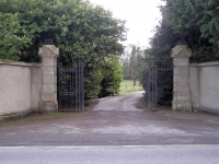 Front entrance gates to Gilford Castle demesne (opposite the present PSNI Station on Banbridge Road, Gilford. Co Down. During WWII 297 Company Royal Engineers were encamped for 3 years (1941-1944) in the fields just inside these gates. The gates had sentry boxes at that time and the sentries often whiled away the time, sharpening their bayonets on the sandstone pillars. The marks can still be clearly seen today.