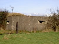 Photo of a WWII Pill Box, sited in Greer\'s field at Madden. The pillbox is one of many remaining throughout Northern Ireland. This one is situated on the Gilford side of the Newry Canal and also overlooks the main Belfast to Dublin Railway line. Nearby on the opposite side of the main Gilford to Tandragee Road, in a field belonging to the Keyes family is another Pill Box (gun emplacement).